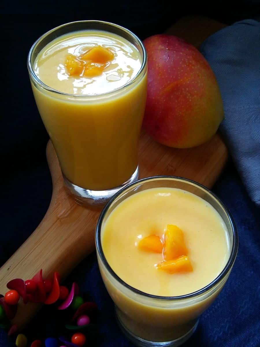 Mango milkshake served in two glasses