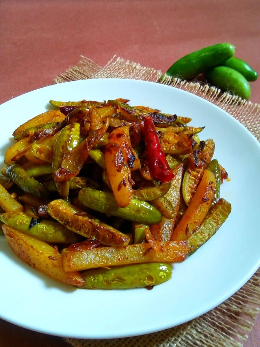 Stir-fried ivy gourd and potato served on a plate
