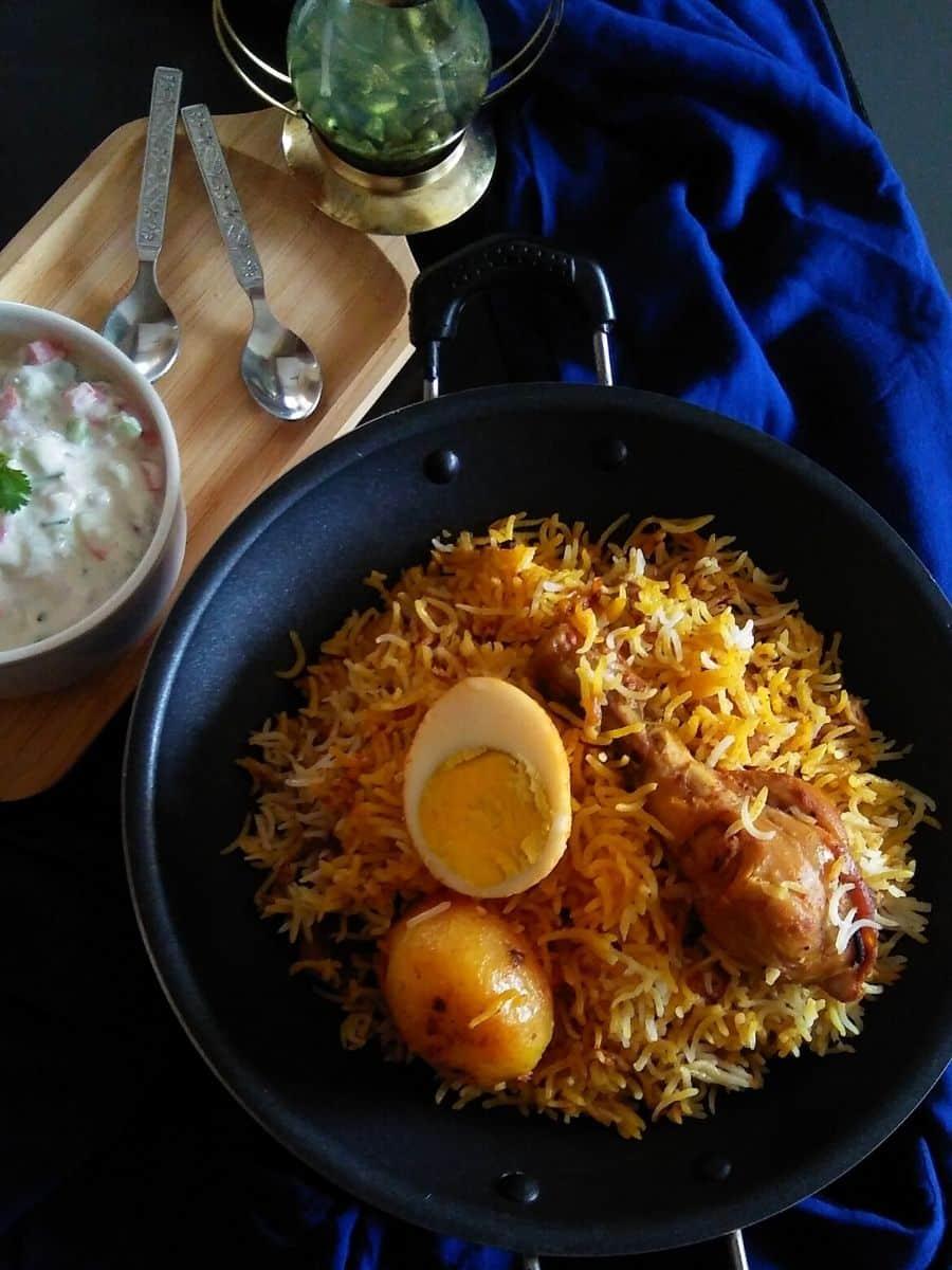 chicken biryani served with raita