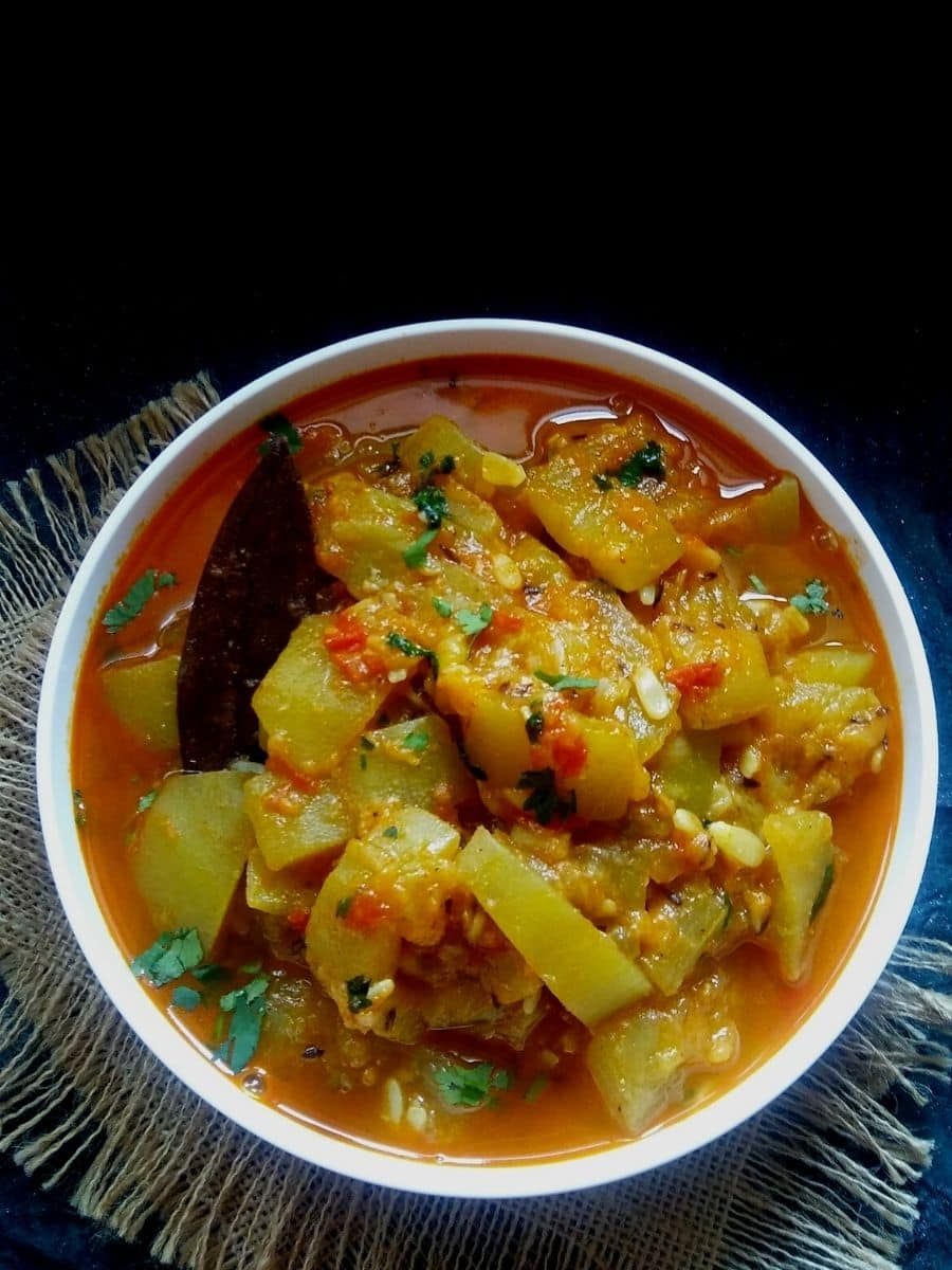 Bottle gourd curry in a white bowl