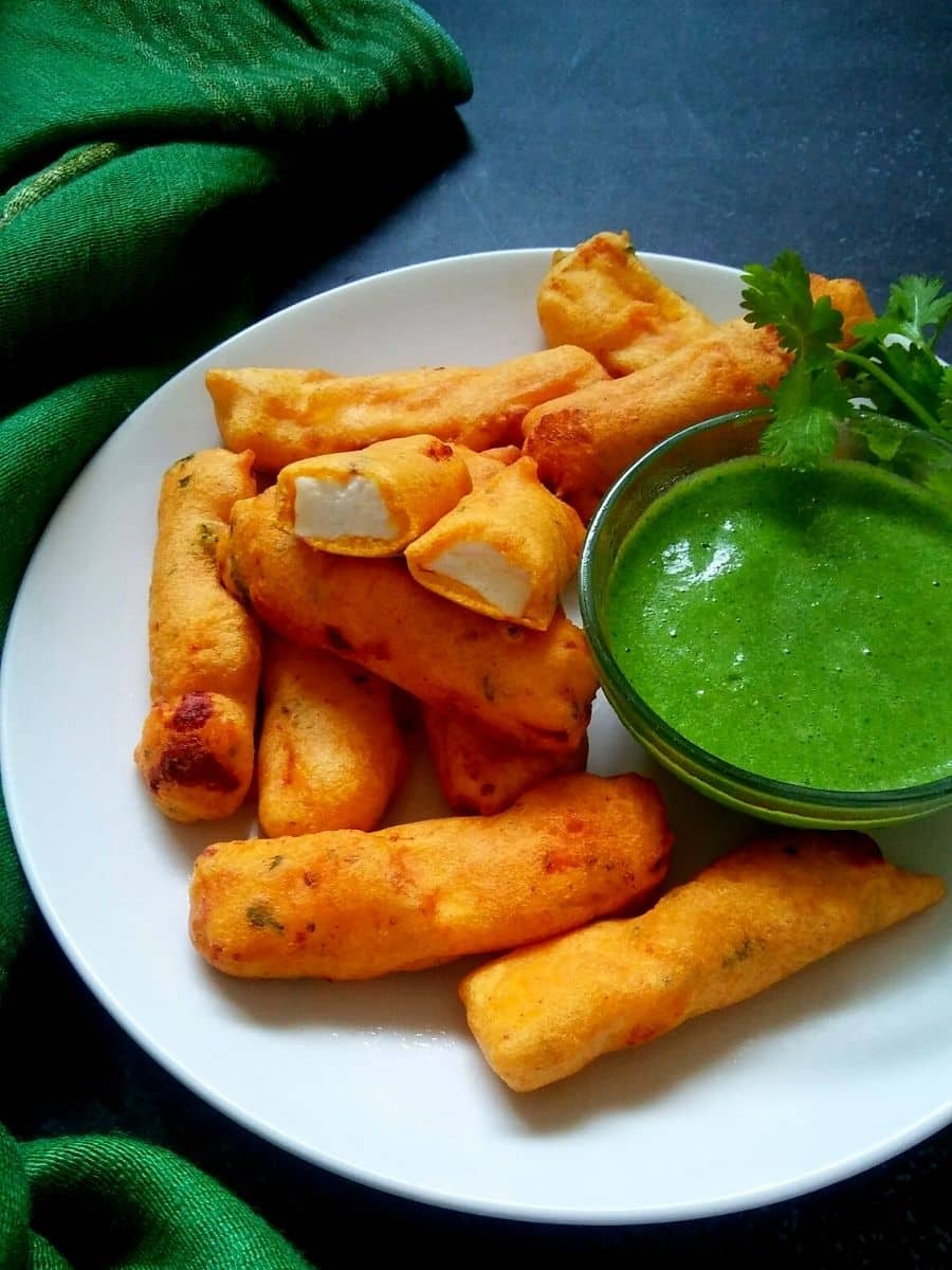 Indian cottage cheese fritters on a white plate