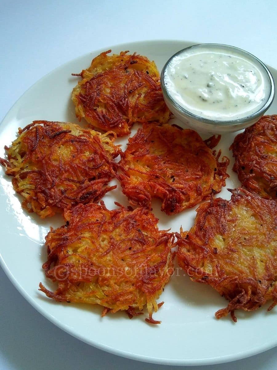 Potato fritters served with yogurt sauce